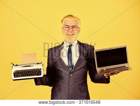 Working Online. Vintage Typewriter. Successful Businessman Use Retro Typewriter And Modern Laptop. M