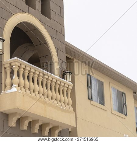 Square Crop Exterior Of Apartment With Moulded White Balustrade On The Arched Balcony