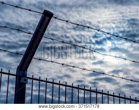 a fence with barbed wire