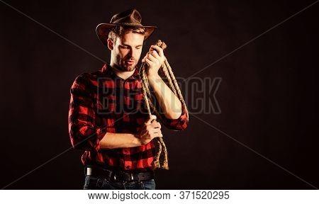 Handsome Rancher. Western Cowboy Portrait. Wild West Rodeo. Man In Hat Black Background. Cowboy With