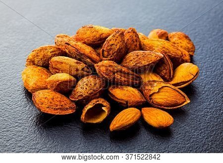 Pile Of Raw Unpeeled Almond On Grey Surface
