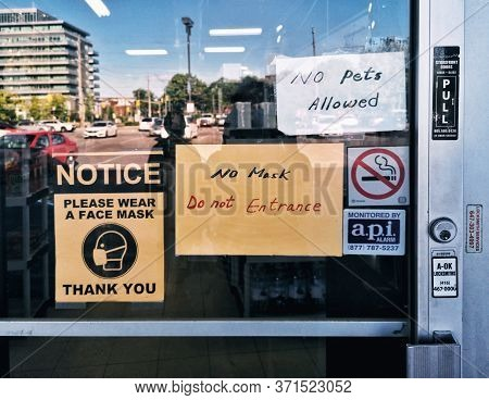 Toronto, Ontario, Canada - June 11, 2020: Warning Notice On Store Shop Door Window Saying To Wear Pr