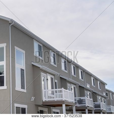 Square Crop Townhouses Exterior With Small Balconies At The Facade In South Jordan Utah