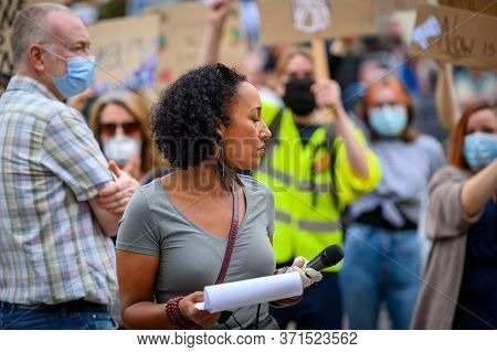 Richmond, North Yorkshire, Uk - June 14, 2020: A Speaker At A Black Lives Matter Protest Takes A Mom