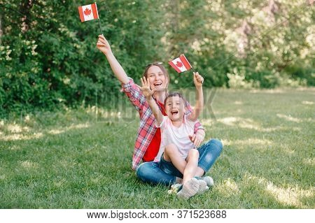 Family Mom With Son Celebrating National Canada Day On 1st Of July. Caucasian Mother With Child Boy
