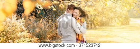 Beautiful Couple Man Woman In Love. Boyfriend And Girlfriend Hugging Outdoor In Park On Autumn Fall