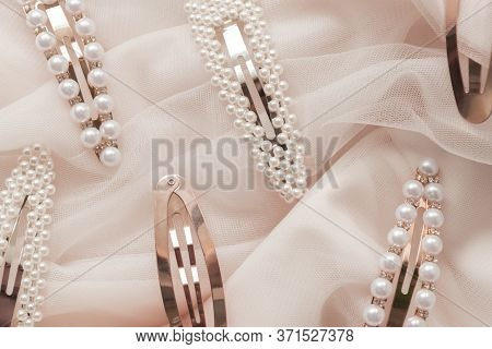 Hair Accessories Trend Concept Pattern Of Hair Clips With Pearls On Pink Tulle Background