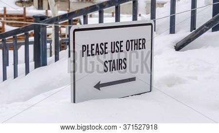 Panorama Crop Stairs Buried In Winter Snow With Sign That Reads Please Use Other Stairs