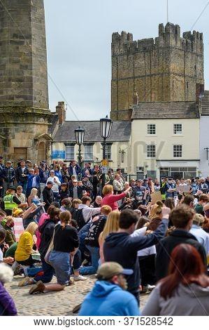 Richmond, North Yorkshire, Uk - June 14, 2020: Black Lives Matter Protesters Kneeling On The Cobbles