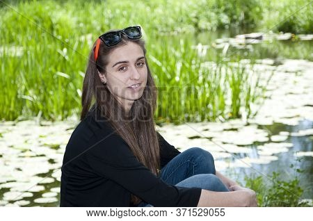 Woman With Long Hair Outdoor. Spring Nature. Blooming Lilly Flower On Lake Water. River Water. Summe
