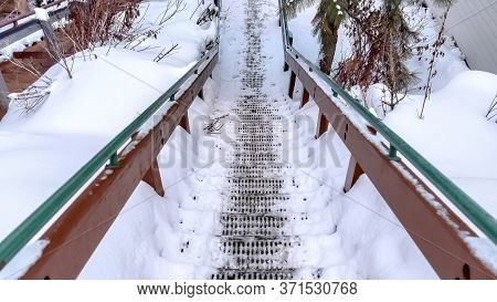 Panorama Crop Grate Metal Tread Stairway On Hill Slope Blanketed With Snow During Winter