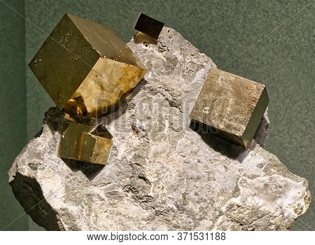 Close-up View Of The Pyrite Cubic Crystals Embedded In A Matrix