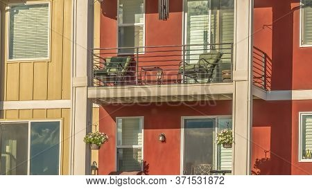Panorama Frame Facade Of Townhouse With Gable Roof Over Balconies Against Blue Sky Background