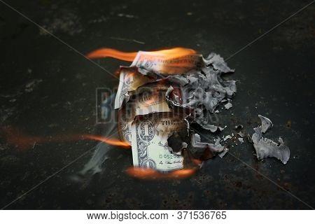 Burned Money, Dollar Bills On Fire, Financial Concept For Economic Crisis, Stock Market Crash, Wage