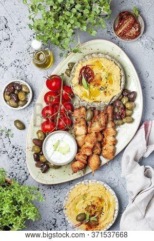 Traditional Greek Chicken Souvlaki With Tzatziki Sauce And Hummus