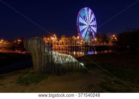 Russia, Irkutsk - June 13, 2020: Colorfull Abstract Ferris Wheel And Abstract Animal From Wooden On