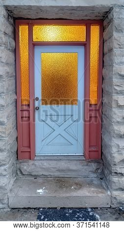 Vertical Frame Frosted Glass Panes On The Front Door Sidelights And Transom Window Of Home