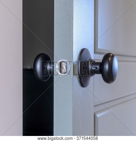 Square Frame Partially Opened Home Bedroom Hinged Wooden Gray Door With Black Door Knob