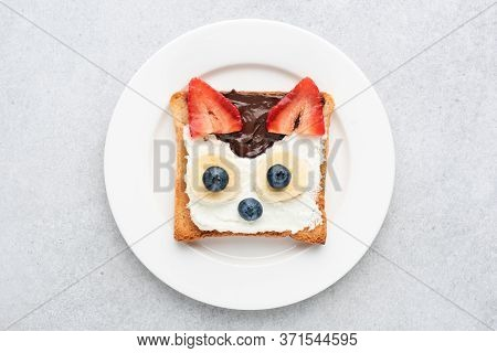 Funny Breakfast Toast For Kids Shaped As Cute Cat. Animal Food Art Sandwich For Kids. Isolated