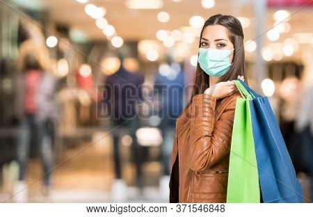 Young woman wearing a mask while shopping