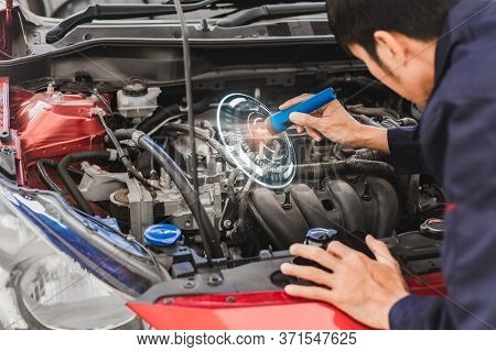 Asian Man Mechanic Inspection Shine A Torch Car Engine Checking Bug In Engine From Application Smart