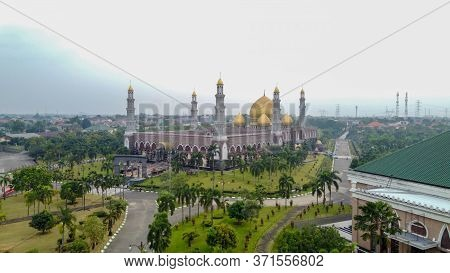 The Largest Mosque Masjid Kubah Emas At Depok, Ramadan Eid Concept Background, Travel And Tourism. D
