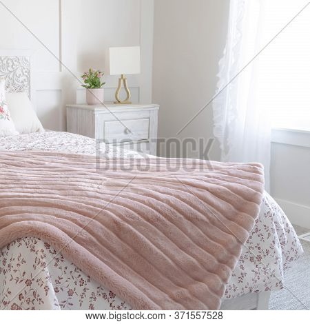 Square Bedroom Interior With Floral Feminine Beddings And Decorative Headboard On Bed