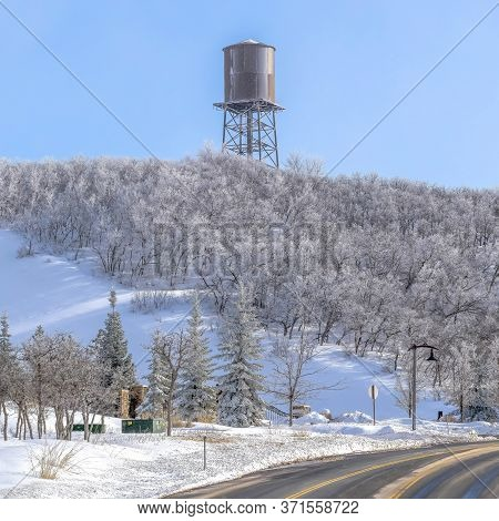 Square Crop Road And Water Tower On The Snow Covered Slopes Of Wasatch Mountain In Winter