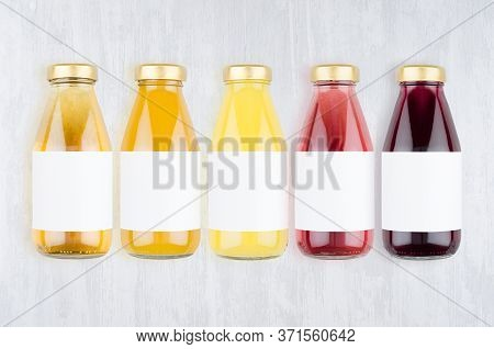 Organic Fruits Juices - Set Of Different Color Juices With Cap In Glass Bottles With Blank Label On