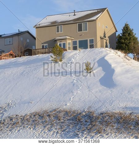 Square Frame Mountain Homes That Lies On Wasatch Mountains Terrain Dusted With Snow In Winter