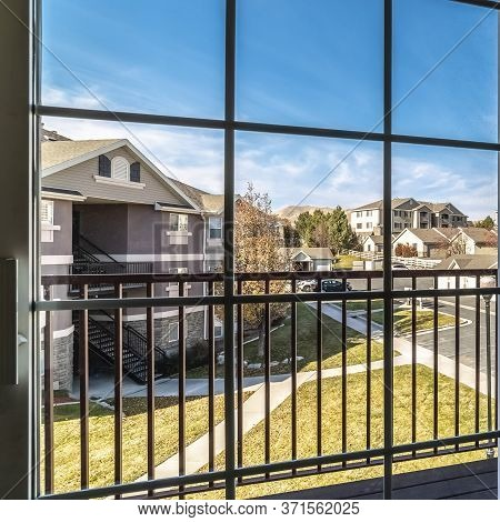 Square Urban Street Viewed Through A Cottage Pane Window