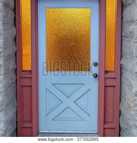 Square Frosted Glass Panes On The Front Door Sidelights And Transom Window Of Home