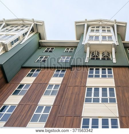 Square Crop Exterior Of Residential Building With Cottage Pane Windows And Wooden Wall