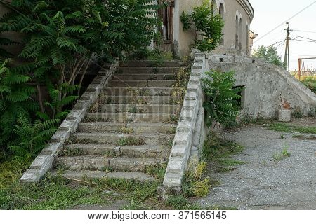Old Overgrown With Destroyed Stone Balustrades Old Antique Steps Of A Stone Staircase. Ruined Stairs
