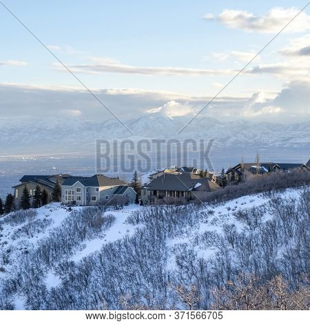 Square Houses On Snowy Mountain Overlooking Wasatch Mountains And Residential Valley