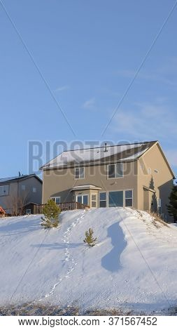 Vertical Crop Mountain Homes Of Wasatch Mountains Against Blue Sky On A Sunny Winter Day
