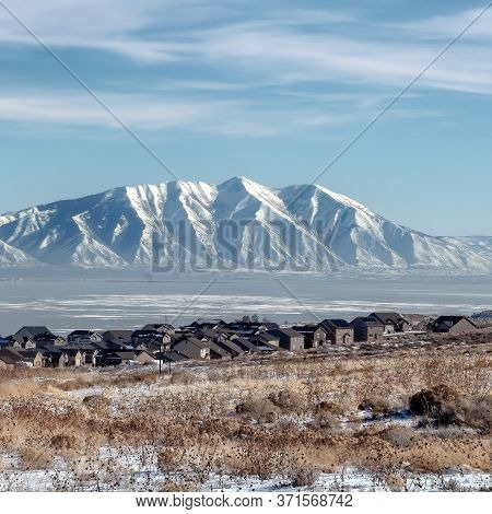 Square Frame Rugged Wasatch Mountains And Icy Utah Lake With Snowy Terrain In The Foreground