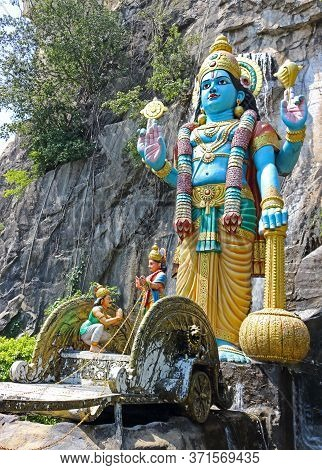Kuala Lumpur, Malaysia - March 15, 2019: Colorful Sculptures Of The Gods At The Entrance To The Rama