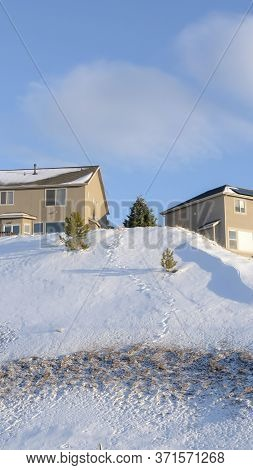 Vertical Wasatch Mountains On A Sunny Winter Day With Mountain Homes Against Blue Sky