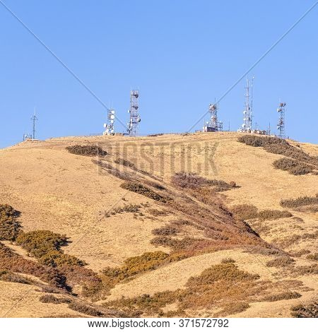 Square Group Of Communications Towers On A Hilltop