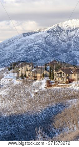 Vertical Homes Nestled Amid Pristine Wasatch Mountain Views Blanketed With Snow In Winter