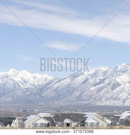 Square Striking Wasatch Mountains And South Jordan City In Utah During Winter Season