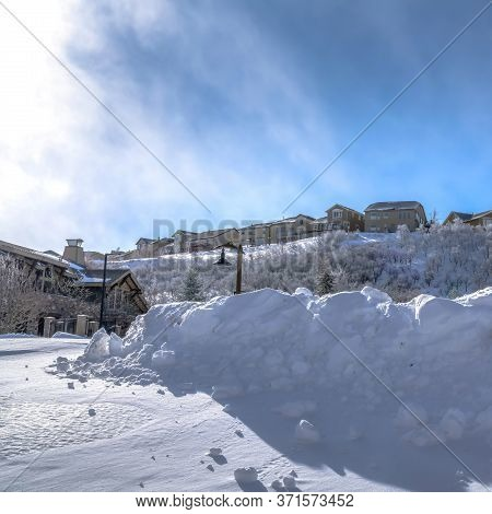 Square Town Nestled Amid Sweeping Terrain Of Wasatch Mountain With Snow In Winter