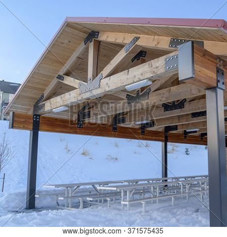 Square Crop Pavilion Attached To A Small Building At The Snowy Slope Of Wasatch Mountains