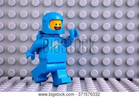 Tambov, Russian Federation - June 04, 2020 Lego Astronaut Minifigures Going On Gray Baseplate Backgr