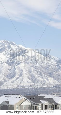 Vertical Frame Neighborhood In South Jordan City 2utah Overlooking Wasatch Mountains In Winter