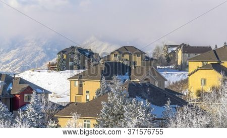 Panorama Crop Houses On Snow Covered Wasatch Mountain Setting On A Sunny Winter Day