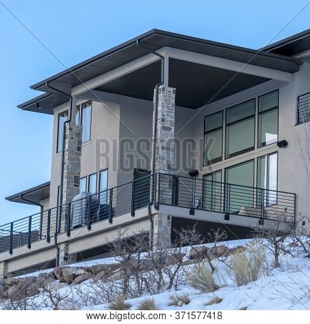 Square Home With Large Balcony That Takes In The Scenic Wasatch Mountain View In Winter