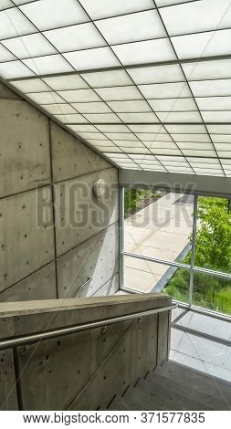 Vertical Frame Commercial Building Interior With Slanted Frosted Glass Roof Over Staircase