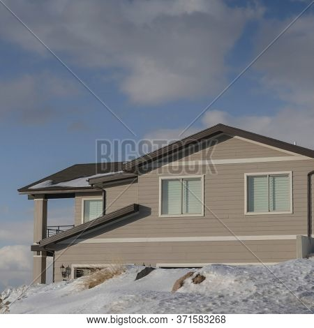 Square Crop Home Against Cloudy Blue Sky At The Snowy Neighborhood Of Wasatch Mountain